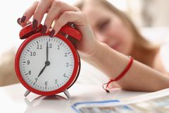 Young beautiful woman waking up in the morning alarm. Concept Stock Images