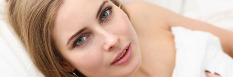 Young beautiful woman waking up in the morning. Concept Royalty Free Stock Images