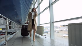 Young and beautiful woman is walking airport hall. stock footage