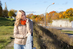 Young beautiful woman walking in autumn park Stock Photography
