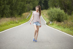 Young Beautiful Woman Walking In A Field, Summer Outdoors Royalty Free Stock Photos