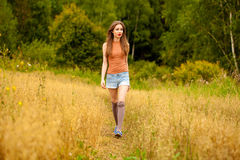 Young Beautiful Woman Walking In A Field, Summer Outdoors Stock Photo
