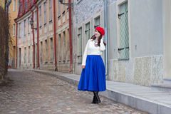 Young beautiful woman walking in medieval town Royalty Free Stock Images