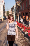 Young beautiful woman walking in the morning town Royalty Free Stock Photo