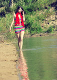 Young beautiful woman walking outdoor in sunny day royalty free stock photography