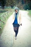 Young beautiful woman walking Stock Images