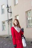 Young beautiful woman walking in the street Stock Image