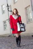 Young beautiful woman walking in Tallinn Stock Photo
