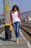 Young beautiful woman walking on trainstation Stock Image