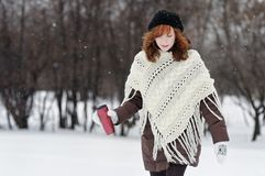 Young beautiful woman walking in winter park Royalty Free Stock Photography