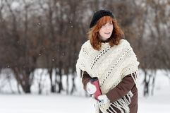 Young beautiful woman walking in winter park Stock Images