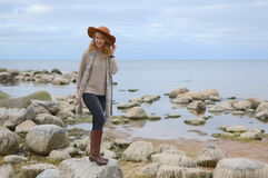 Young beautiful woman walks on the sea Royalty Free Stock Photography