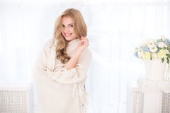 Young beautiful woman in warm knitted handmade clothes at home. Royalty Free Stock Photo