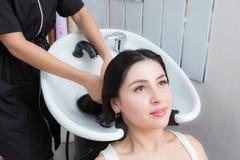 Woman wash their hair in a beauty salon