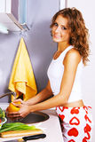 Young beautiful woman washing vegetables Stock Photos
