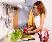 Young beautiful woman washing vegetables Stock Photography