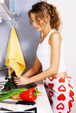 Young beautiful woman washing vegetables Royalty Free Stock Photos