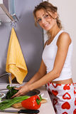 Young beautiful woman washing vegetables Stock Photo