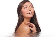 Young beautiful woman in water Stock Photography