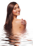 Young beautiful woman in water Stock Photos