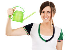Young beautiful woman with watering can Royalty Free Stock Image