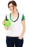 Young beautiful woman with watering can Royalty Free Stock Photos