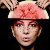 Young beautiful woman and watermelon portrait Stock Photos