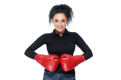 Young beautiful woman wearing boxing gloves royalty free stock photo