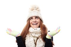Young beautiful woman wearing cap, scarf and gloves Stock Photo