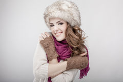 Young beautiful woman wearing fur hat and scarf Royalty Free Stock Photos