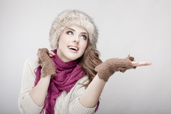 Young beautiful woman wearing fur hat and scarf Stock Images