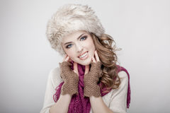 Young beautiful woman wearing fur hat and scarf. This image has attached release Stock Image