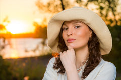 Young and beautiful woman wearing a hat. In sunset light Stock Images