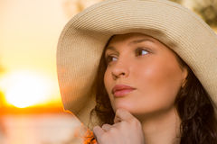 Young and beautiful woman wearing a hat. In sunset light Stock Photo