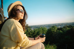 Young and beautiful woman wearing a hat in sunset light Royalty Free Stock Photo