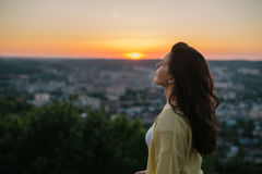 Young and beautiful woman wearing a hat in sunset light Stock Photography
