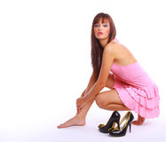Young beautiful woman wearing high heels sitting Royalty Free Stock Photography