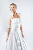 Young beautiful woman wearing luxurious wedding dress Royalty Free Stock Photo