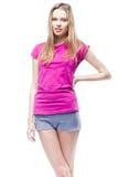 Young beautiful woman wearing pink t-shirt Stock Photo