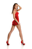 Young Beautiful Woman wearing a red dress Royalty Free Stock Image