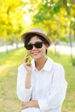 Young beautiful woman wearing sun glasses and fashion straw hat Stock Photo
