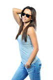 Young beautiful woman wearing sunglasses while posing isolated o Stock Photos