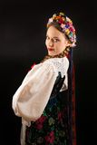 A young beautiful woman wearing a traditional Polish folk costume Royalty Free Stock Photography
