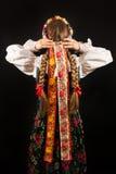 A young beautiful woman wearing a traditional Polish folk costume Stock Photo