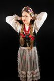 A young beautiful woman wearing a traditional Polish folk costume Stock Images
