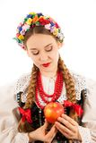 A young beautiful woman wearing a traditional Polish folk costume Royalty Free Stock Photo