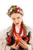 A young beautiful woman wearing a traditional Polish folk costume Stock Photos