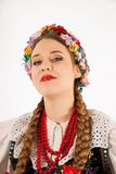 A young beautiful woman wearing a traditional Polish folk costume Royalty Free Stock Images