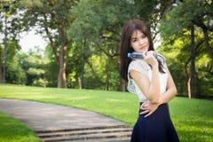 Young beautiful  woman wearing white shirts drinking water at su Royalty Free Stock Photo