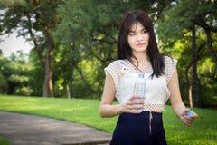 Young beautiful  woman wearing white shirts drinking water at su Royalty Free Stock Photos